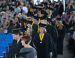 Graduates file in during the 2015 Western Nevada College Commencement held at the Pony Express Pavilion in Carson City, Nev., on Monday, May 18, 2015.<br /> Photo by Tim Dunn