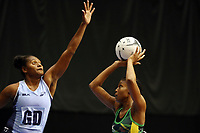 21.02.2018 Jamaica's Rebekah Robinson and Fiji's Alisi Naqiri in action during the Jamaica v Fiji Taini Jamison Trophy netball match at the North Shore Events Centre in Auckland. Mandatory Photo Credit ©Michael Bradley.