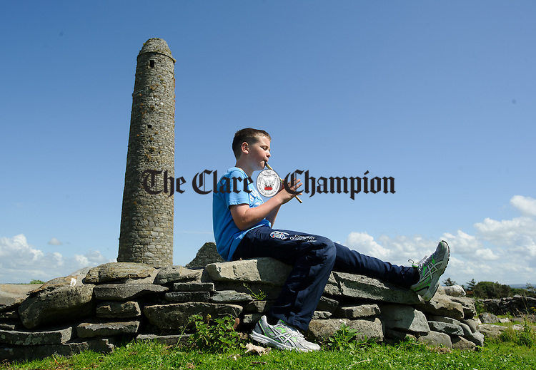 Cree's Liam Browne plays tin whistle during a trip to Scattery Island as part of the Kilrush Traditional Music and Set dancing Festival. Photograph by John Kelly.