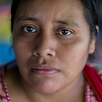 20 noviembre 2014. <br /> Micaela Antonio ( 32 a&ntilde;os) Activista en contra de la hidroel&eacute;ctrica Ecoener, en Santa Cruz de Barillas, Guatemala.<br /> La llegada de algunas compa&ntilde;&iacute;as extranjeras a Am&eacute;rica Latina ha provocado abusos a los derechos de las poblaciones ind&iacute;genas y represi&oacute;n a su defensa del medio ambiente. En Santa Cruz de Barillas, Guatemala, el proyecto de la hidroel&eacute;ctrica espa&ntilde;ola Ecoener ha desatado cr&iacute;menes, violentos disturbios, la declaraci&oacute;n del estado de sitio por parte del ej&eacute;rcito y la encarcelaci&oacute;n de una decena de activistas contrarios a los planes de la empresa. Un grupo de ind&iacute;genas mayas, en su mayor&iacute;a mujeres, mantiene cortado un camino y ha instalado un campamento de resistencia para que las m&aacute;quinas de la empresa no puedan entrar a trabajar. La persecuci&oacute;n ha provocado adem&aacute;s que algunos ecologistas, con &oacute;rdenes de busca y captura, hayan tenido que esconderse durante meses en la selva guatemalteca.<br /> <br /> En Cob&aacute;n, tambi&eacute;n en Guatemala, la hidroel&eacute;ctrica Renace se ha instalado con amenazas a la poblaci&oacute;n y falsas promesas de desarrollo para la zona. Como en Santa Cruz de Barillas, el proyecto ha dividido y provocado enfrentamientos entre la poblaci&oacute;n. La empresa ha cortado el acceso al r&iacute;o para miles de personas y no ha respetado la estrecha relaci&oacute;n de los ind&iacute;genas mayas con la naturaleza. &copy;Calamar2/ Pedro ARMESTRE<br /> <br /> The arrival of some foreign companies to Latin America has provoked abuses of the rights of indigenous peoples and repression of their defense of the environment. In Santa Cruz de Barillas, Guatemala, the project of the Spanish hydroelectric Ecoener has caused murders, violent riots, the declaration of a state of siege by the army and the imprisonment of a dozen activists opposed to the project . <br /> A group of M