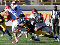 Cedric Dozier of California tackles Vince Mayle of Washington State during the game at Memorial Stadium in Berkeley, California on October 5th, 2013.  Washington State defeated California, 44-22.