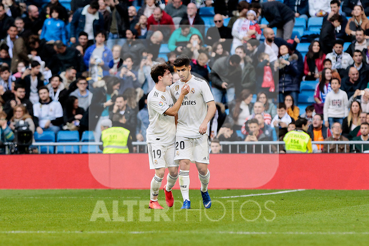Real Madrid's Alvaro Odriozola (L) and Marco Asensio (R) celebrate goal during Copa del Rey match between Real Madrid and UD Melilla at Santiago Bernabeu Stadium in Madrid, Spain. December 06, 2018. (ALTERPHOTOS/A. Perez Meca)