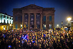 © Joel Goodman - 07973 332324 . 17 November 2013 . Oldham , UK . Crowds in front of the old Town Hall , opposite the stage . The Christmas lights are turned on in Oldham Town Centre . Photo credit : Joel Goodman