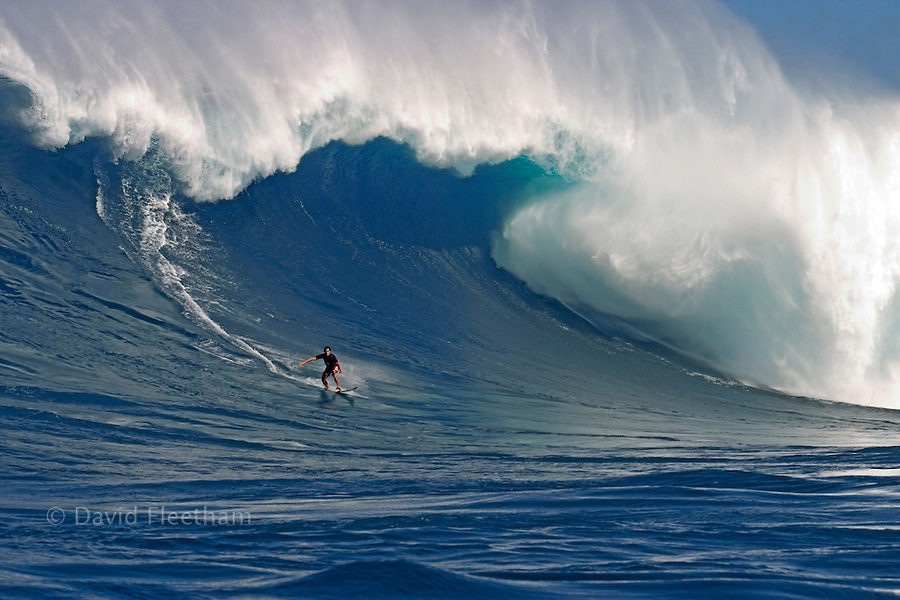 A tow-in surfer drops to the curl of Hawaii's big surf at Peahi (Jaws) off Maui.