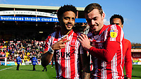 Lincoln City's Bruno Andrade, left, and Lincoln City's Harry Toffolo celebrate after securing promotion from Sky Bet League Two<br /> <br /> Photographer Chris Vaughan/CameraSport<br /> <br /> The EFL Sky Bet League Two - Lincoln City v Cheltenham Town - Saturday 13th April 2019 - Sincil Bank - Lincoln<br /> <br /> World Copyright © 2019 CameraSport. All rights reserved. 43 Linden Ave. Countesthorpe. Leicester. England. LE8 5PG - Tel: +44 (0) 116 277 4147 - admin@camerasport.com - www.camerasport.com