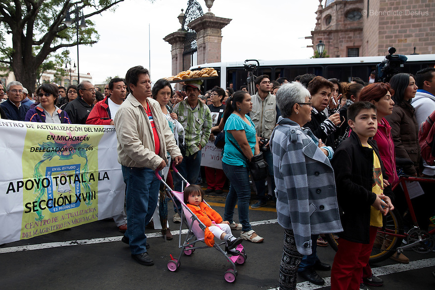 Demonstrators march to demande justice for the disappearance of 43 students from Ayotzinapa's teacher training college in Morelia, Michoacan, Mexico on November 19, 2014. The relatives of the 43 missing students still do not believe the official line that the young men are all dead, and with classmates, social organizations and human rights defenders, they started on Thursday a national caravan. They split up into three different caravans, branching out to share information face to face with supporters in other cities and rally nationwide support. The three groups will meet in Mexico City on Thursday 20 for a general strike and massive marches to demand justice and fight against corrupted government and organized crime. Criticism of the government has intensified in Mexico, and many are demanding that the search for the 43 missing students continue until there is concrete evidence to the contrary. (Photo by Bénédicte Desrus)