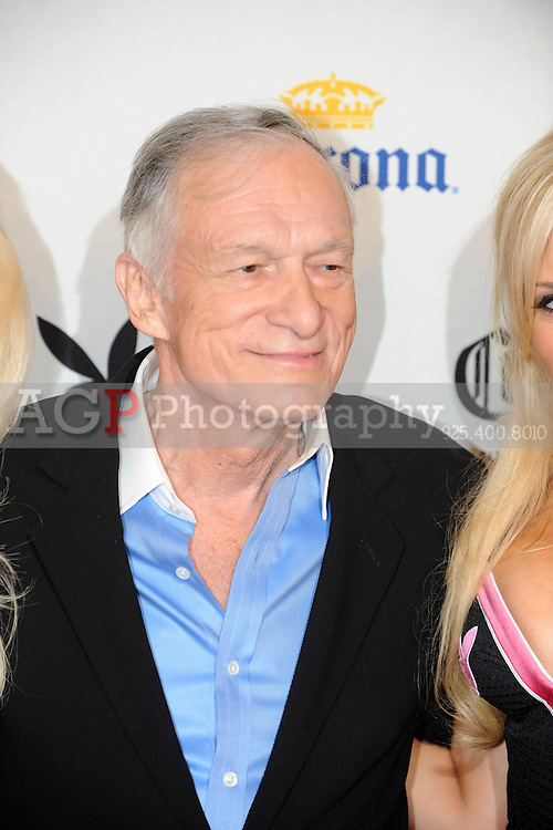 """Playboy Magazine founder Hugh Hefner poses at Playboy's ninth annual """"Super Saturday Night""""  party in at Playboy's Desert Oasis and Resort in Chandler, Arizona Saturday February 2, 2008.   (Photo by Alan Greth)"""