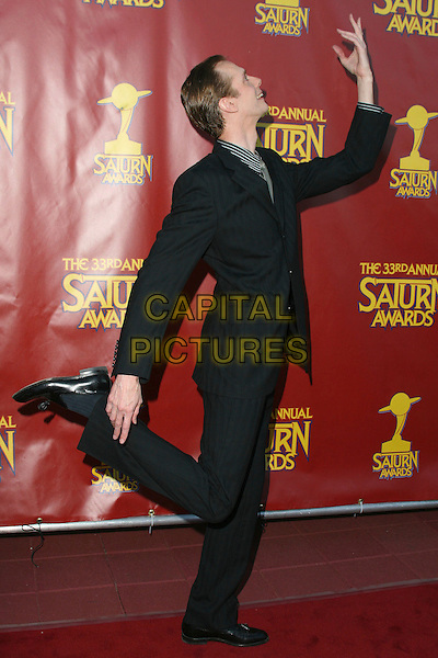 DOUG JAMES.33rd Annual Saturn Awards presented by the Academy Of Science Fiction, Fantasy and Horror Films held at the Universal City Hilton Hotel,Universal City, California, USA, 10 May 2007..full length black suit holding leg hand.CAP/ADM/CH.©Charles Harris/AdMedia/Capital Pictures.