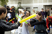 "Spain. Province of Madrid. Madrid. A group of young people celebrate the ""Feliz Dia Frikis"". May 25th is the International Freak Pride's Day. The word freak when used in a slang context also has positive connotations. It can be used to describe one who denotes a strong fondness or even obsession with a particular activity, like a passion for Star wars. Friendly fights between the Good and the Bad guys. Yellow and blue balloons are used as swords. Downtown. Town center. Santo Domingo place. © 2007  Didier Ruef"