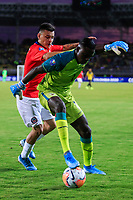 PEREIRA, COLOMBIA - JANUARY 18: Chile's Pablo Aranguiz, (L) fights for the ball  against Ecuador's goalkeeper Wellintong Ramirez during their CONMEBOL Preolimpico soccer game at the Hernan Ramirez Villegas Stadium on January 18, 2020 in Pereira, Colombia. (Photo by Daniel Munoz/VIEW press/Getty Images)
