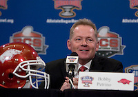 Arkansas Head Coach Bobby Petrino talks to the reporters during the Head Coaches' Press Conference at Marriott at the Convention Center in New Orleans, Louisiana on January 3rd, 2011.