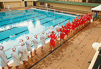 Stanford - February 1, 2015: Stanford team greets UCLA before the Stanford vs UCLA title match of the 2015 Stanford Invitational at Avery Aquatic Center on Sunday afternoon.<br /> <br /> The Cardinal defeated the Bruins 9-5.