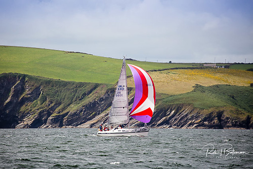 Reaching home under spinnaker along the Kinsale coast Photo: Bob Bateman