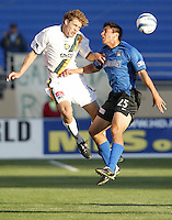 22 May 2004: Earthquakes Brian Ching battles for the ball in the air against Galaxy midfielder Sasha Victorine at Spartan Stadium in San Jose, California.   Earthquakes defeated Galaxy 4-2. Mandatory Credit: Michael Pimentel / ISI