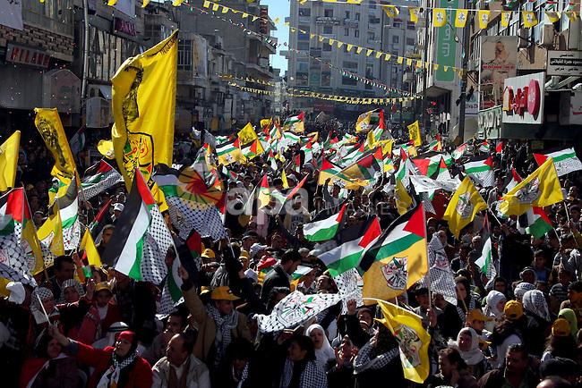 Palestinian Fatah supporters participate in a rally marking the movement's 45th anniversary in the West Bank city of  Ramallah,Wednesday, Jan 6, 2010. Photo by Issam Rimawi