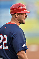 Hagerstown Suns manager Patrick Anderson (22) coaches third base during a game against the  Asheville Tourists at McCormick Field on September 4, 2016 in Asheville, North Carolina. The Suns defeated the Tourists 10-5. (Tony Farlow/Four Seam Images)