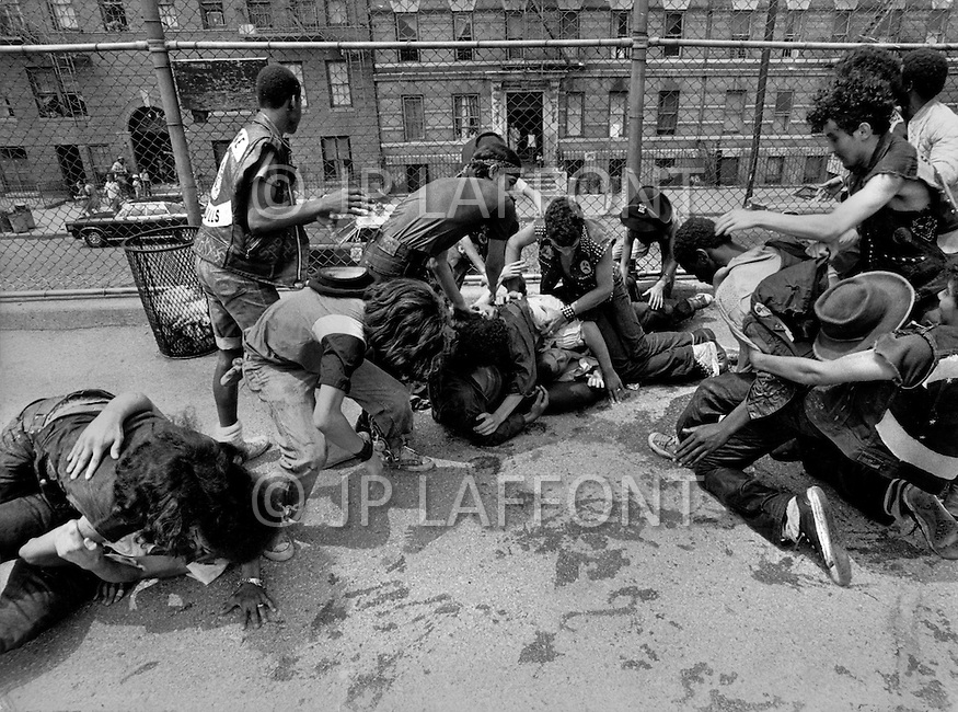"New York, NY July 20th 1972. New York street gang ""Savage Skulls"". The trademark of the primarily Puerto Rican gang was a sleeveless denim jacket with a skull and crossbones design on the back. Based in the Hunts Point area of the South Bronx, the gang declared war on the drug dealers that operated in the area. Running battles were frequent with rival gangs ""Seven Immortals"" and ""Savage Nomads"". - members of the ""Dirty Dozen"" gang"