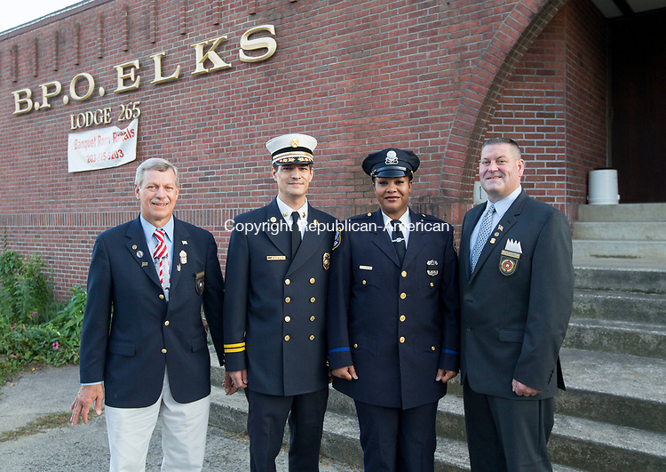 Waterbury, CT-15, September 20107-091517CM03  From left, Eugene LaFauci, Exalted Ruler Waterbury Elks Lodge #265, Battalion Chief, Jim Peplau who was named firefighter of the year, Officer Andrea Saunders, who was named police officer of the year and Waterbury Police Sergeant David Knapp, who is also past Exalted Ruler of Elks Lodge #265 stand for a photo outside the lodge in Waterbury on Friday. Two veteran first responders were recognized for their efforts within the community during a ceremony Friday at the Elks Lodge.  Waterbury Police Department Officer Andrea Saunders and Battalion Fire Chief Jim Peplau were recognized as police and firefighter of the year. Saunders, a member of the police force since 2006, was awarded an excellent police duty medal in 2010 for her work in identifying three men involved in a bar fight, one of whom was armed with a gun. She received a second medal late last year after she detained a group of suspected car thieves, one of which was later found carrying a pistol. In addition to engaging with neighborhood residents to tackle their issues, she also created Brass City Cares, which equipped more than 175 children with school supplies.  Peplau, a member of the city's fire department since 1994, has been instrumental in using grant funding to outfit and equip firefighters with the gear they need. That includes rescue equipment, a fitness center and mobile computers. <br /> He puts in that hard work and effort so that the safety of his fellow firefighters can be improved.<br />      Christopher Massa Republican-American