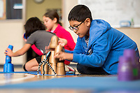 NWA Democrat-Gazette/JASON IVESTER <br /> Ulises (cq) Garcia, Elza Tucker Elementary fifth-grader, races the clock on Thursday, Nov. 12, 2015, while participating in World Stack Up Day at the Lowell school. About 600 students at the school helped contribute to the event which hoped to break the Guinness World Record of most people sport stacking at multiple locations in one day. Stacking is a sport involving fitness, agility, concentration and speed in stacking special cups in certain sequences as quickly as possible. The current record is 592,292 stackers.