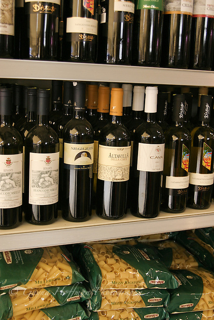 Wine and pasta on grocery store shelves. Sicily, Italy