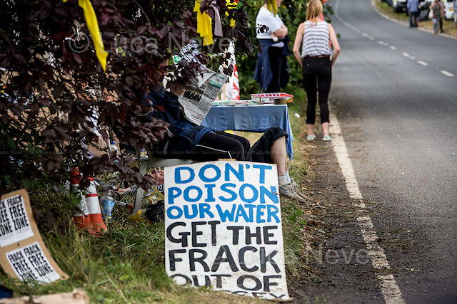 Balcombe, West Sussex (UK), 02/08/2013. Day 9 of the demonstrations against hydraulic fracturing - also known as fracking - in the West Sussex village of Balcombe. The energy firm Cuadrilla in charge of the shale-gas drilling, began its first test (drilling a 3,000ft - 914m - vertical well and a 2,500ft - 762 m - horizontal bore) today at 11:15 BST to see if oil or gas, if found, can be extracted. In the meanwhile, protesters, activists and local residents, who fear pollution from gas flaring, the possible pollution of local water, increasing of cancers and the damages to the ecosystem, repeatedly tried to stop the lorries which were carrying equipment for the drilling. The protesters were stopped by the Sussex police and 3 arrests were made.