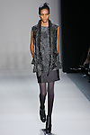 Rose Cordero walks the runway in a Nicole Miller Fall 2011 outfit, during Mercedes-Benz Fashion Week.