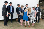 Festival of Hunting Peterborough Uk. Hunt staff also know as Hunt servants wearing their dress code dark suits and wearing bowler hats and girlfriends and partners. 2013.