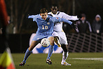 11 December 2009: UNC's Billy Schuler (10) and Akron's Kofi Sarkodie (4). The University of Akron Zips defeated the University of North Carolina Tar Heels 5-4 on penalty kicks after the game ended in a 0-0 overtime tie at WakeMed Soccer Stadium in Cary, North Carolina in an NCAA Division I Men's College Cup Semifinal game.