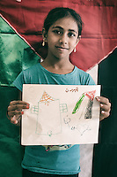 Kids posing with their drawing of Palestine. Here in Shatila there are two to three generations of Palestinians, the kids are born here, their parents also, the souvenir of Palestine is being lost from generation to generation. Shatila camp, Beirut, Lebanon. 2015