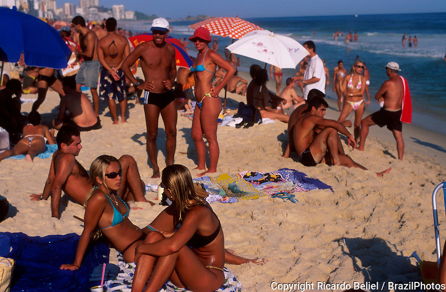 Young and beautiful people socialize at Ipanema beach on a suuny day, Rio de Janeiro lifestyle, Brazil.