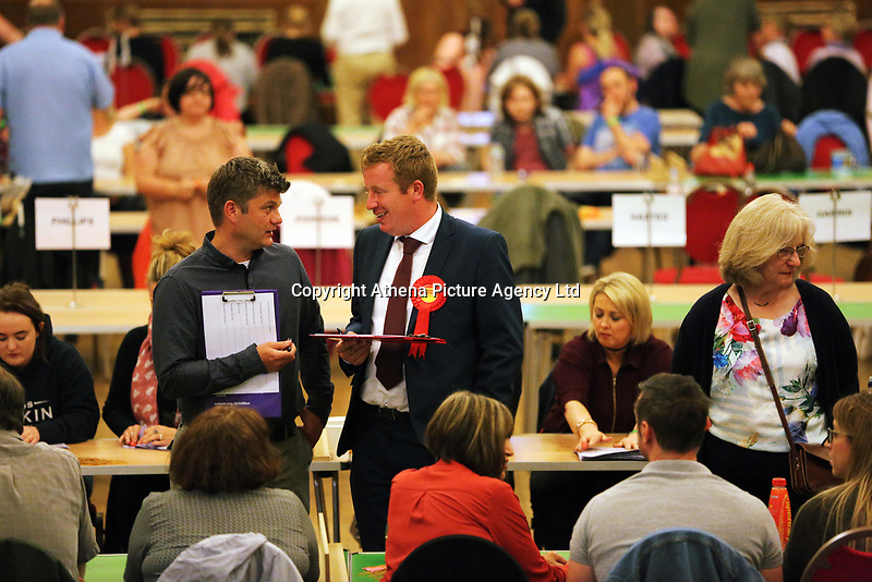 Pictured: Party representatives pause to chat. Friday 09 June 2017<br />Re: Counting of ballots at Brangwyn Hall for the general election in Swansea, Wales, UK