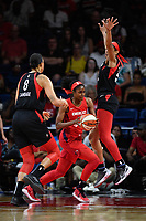 Washington, DC - July 13, 2019: Washington Mystics forward LaToya Sanders (30) splits Las Vegas Aces defenders Liz Cambage (8) and A'ja Wilson (22) on her way to the basket during 1st half action of game between Las Vegas Aces and Washington Mystics at the Entertainment & Sports Arena in Washington, DC. (Photo by Phil Peters/Media Images International)