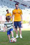 06 December 2014: Los Angeles's Robbie Keane (IRL) kicks the ball around with his son. Major League Soccer held a training sessions at the StubHub Center in Carson, California one day before the Los Angeles Galaxy hosted the New England Revolution in MLS Cup 2014.