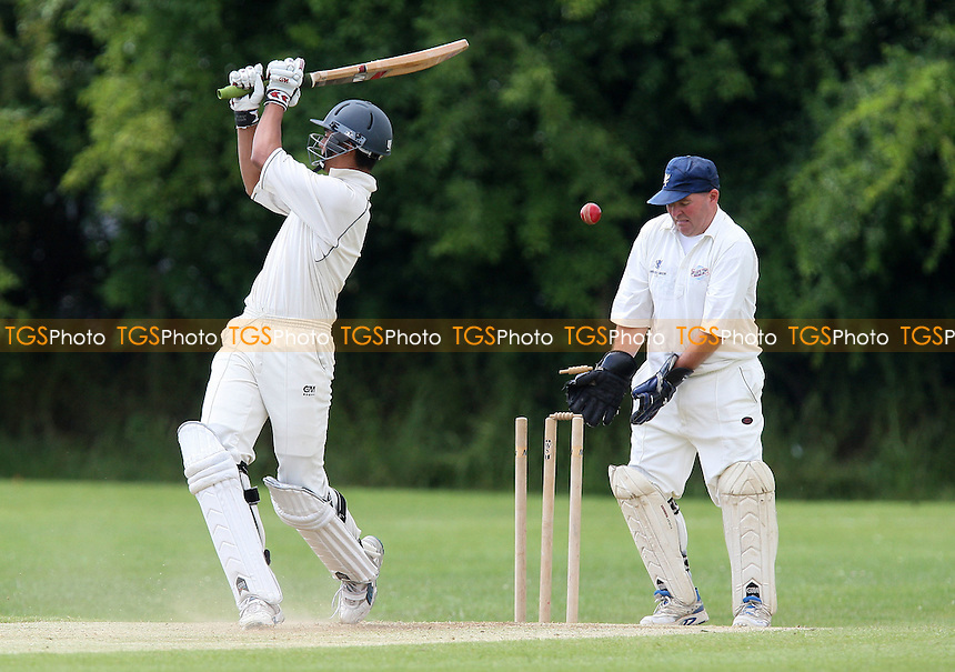 M Nasim of Hainault & Clayhall is clean bowled by Sutton - Ardleigh Green CC 3rd XI vs Hainault & Clayhall CC 3rd XI - Essex Cricket League - 12/06/10 - MANDATORY CREDIT: Gavin Ellis/TGSPHOTO - Self billing applies where appropriate - Tel: 0845 094 6026
