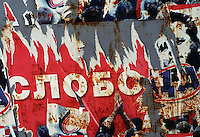 A worn out political poster in favor of former dictator Slobodan Milosevic. Milosevic, who controlled the country through one decade of war and who recently died in prison, was ousted in the 1999 and replaced by a pro-democracy government. Belgrade, Serbia, Yugoslavia. June, 2001.