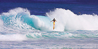 A surfer hits the backwash and is projected into the air along with his surfboard at Pupukea on Oahu's North Shore.