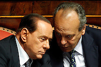 Il senatore Nitto Palma parla al leader del PdL Silvio Berlusconi, a sinistra, durante la discussione sulla mozione di sfiducia nei confronti del Ministro dell'Interno e Vicepresidente del Consiglio al Senato, Roma, 19 luglio 2013.<br /> Senator Nitto Palma talks to People of Freedom (PdL) party's leader Silvio Berlusconi, left, during a plenary session for the discussion of a no confidence motion against Interior Minister and Deputy Premier, at the Senate in Rome, 19 July 2013.<br /> UPDATE IMAGES PRESS/Riccardo De Luca