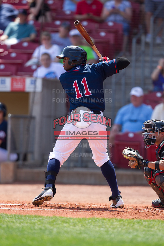 Cedar Rapids Kernels outfielder Romy Jimenez #11 bats during a game against the Lansing Lugnuts at Veterans Memorial Stadium on April 30, 2013 in Cedar Rapids, Iowa. (Brace Hemmelgarn/Four Seam Images)