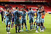 Forest Green Rovers players celebrate winning the penalty shoot-out which sends Forest Green Rovers into the second round during Charlton Athletic vs Forest Green Rovers, Caraboa Cup Football at The Valley on 13th August 2019