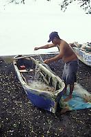 Nicarguan fiisherman preparing his nets and boat, Isla de Ometepe, Nicaragua
