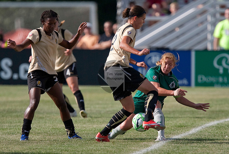 July 26 2009     FC Gold Pride player Christine Sinclair (12, center) tries to keep the ball from going out of bounds, as Athletica captain Lori Chalupny (17, right) slides in.  At far left is Gold Pride's Formiga (31).  First half action.  The game ended in a 1-1 tie.    The St. Louis Athletica hosted the FC Gold Pride on Sunday July 26, 2009 at the Anheuser Busch Soccer Park in Fenton, Missouri.   ..            *******EDITORIAL USE ONLY*******