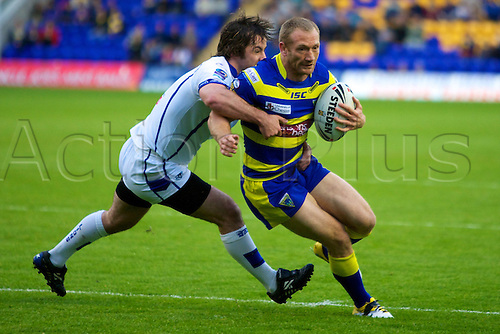 20.05.2011. Warrington Wolves v Swinton Lions. Michael Monaghan can't avoid the Swinton player. Warrington Wolves 112 Swinton Lions 0.