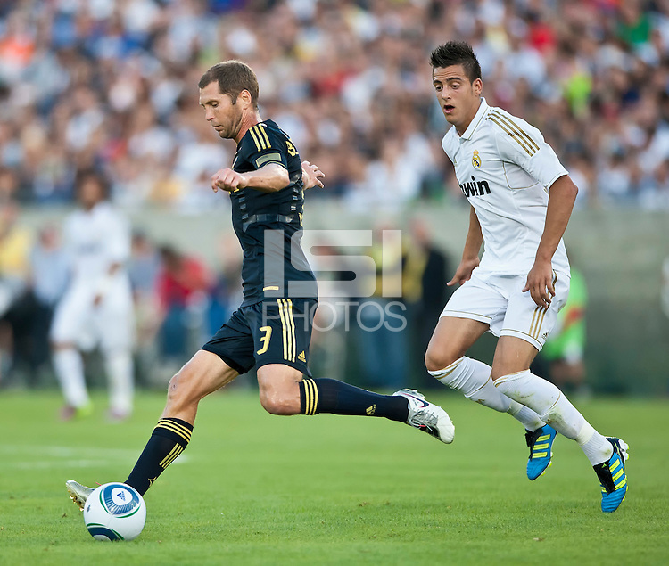 LOS ANGELES, CA – July 16, 2011: Gregg Berhalter (3) of the LA Galaxy and Joselu (29) of Real Madrid during the match between LA Galaxy and Real Madrid at the Los Angeles Memorial Coliseum in Los Angeles, California. Final score Real Madrid 4, LA Galaxy 1.