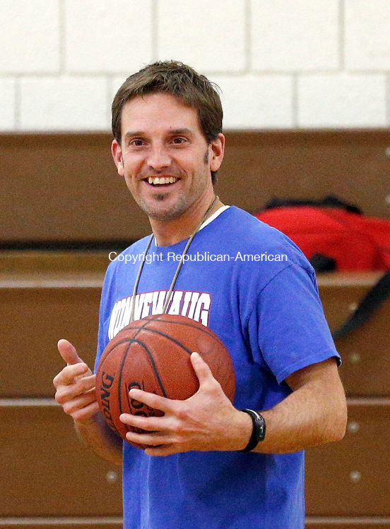 Woodbury, CT- 03 December 2015-120315CM02- Nonnewaug girls head basketball coach Adam Brutting leads his girls during practice in Woodbury on Thursday.      Christopher Massa Republican-American