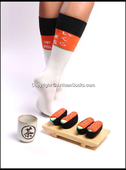 BNPS.co.uk (01202 558833)<br /> Pic: ArtisanSocks/BNPS<br /> <br /> ***Must Use Full Byline***<br /> <br /> Salmon roe sushi socks.<br /> <br /> Soft Sushi Shuffle...<br /> <br /> Now, should you wish to, you can make your sock draw look like a sushi bar.<br /> <br /> These morsels of mouthwatering sushi might look tantalising but you wouldn't want to eat them - because they're actually rolled up socks.<br /> <br /> The super-realistic items of clothing are the latest bizarre trend sweeping the fashion world and have been an instant hit with shoppers.<br /> <br /> Unrolled they look like any other sock but rolled up they form seven different varieties of the raw fish snack, transforming your underwear drawer into a smorgasbord of sushi.<br /> <br /> The life-like 'flavours' include egg (tamago), salmon roe (ikura), shrimp (ebi), octopus (tako), tuna (maguro ), salmon (sa-mon) and trout (masuzishi).<br /> <br /> Sushi socks cost $6 a pair - around £3.70 - and can be bought from artisansocks.com.