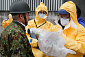 March 17, 2011, Nihon-Matsu, Japan - Medical staff in protective gear check radiation levels on local residents in Nihon-Matsu, Fukushima prefecture, on Tuesday, March 15, 2011. A nuclear power plant, located along the Pacific coast some 65km southeast of Nihon-Matsu, has had a series of trouble in its reactors since a magnitude 9.0 earthquake hit northeastern Japan on March 11. (Photo by AFLO) [3609] -mis-