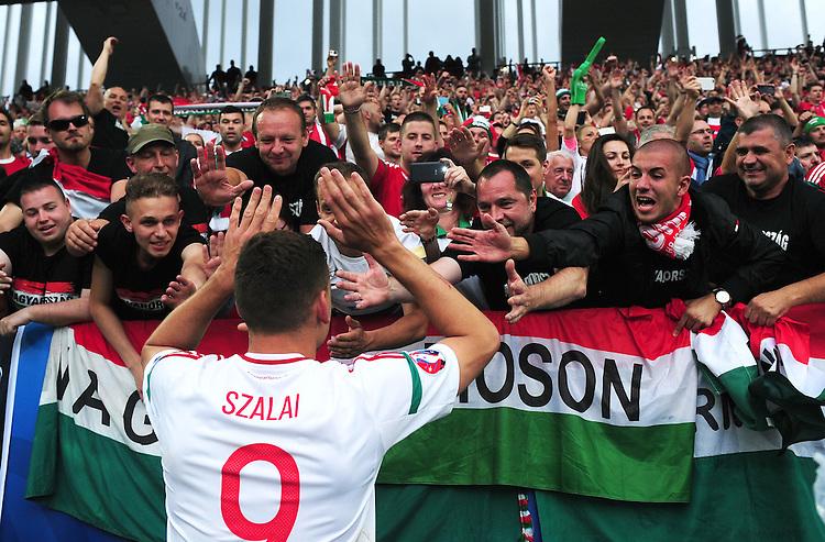 Hungary's Adam Szalai celebrates with fans after his sides 2-0 win over Austria<br /> <br /> Photographer Kevin Barnes/CameraSport<br /> <br /> International Football - 2016 UEFA European Championship -  Group F - Austria v Hungary - Tuesday 14th June 2016 - Stade de Bordeaux, Bordeaux, France<br /> <br /> World Copyright &copy; 2016 CameraSport. All rights reserved. 43 Linden Ave. Countesthorpe. Leicester. England. LE8 5PG - Tel: +44 (0) 116 277 4147 - admin@camerasport.com - www.camerasport.com