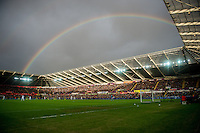 A rainbow forms over the stadium during the English Premier League game between Arsenal and Swansea at the Liberty Stadium in Swansea ,Wales, UK. Saturday 14 January 2017