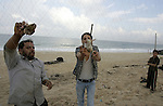 Palestinians catche the migrant quail, where hunted on the beach of Khan Younis, southern Gaza Strip on  Sept. 25, 2011. Palestinians erected hundreds of meters of nets along the coastline in the Gaza Strip to hunt migratory birds, mainly quails, which arrive to the coasts of the Mediterranean in the second half of September of each year. Photo by Abed Rahim Khatib