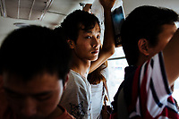 People ride a public bus in Xian, Shaanxi Province, China.
